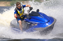 man riding blue jetski